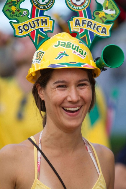 soccer fan wearing a makarapa - a construction helmet specially decorated for the world cup 2010