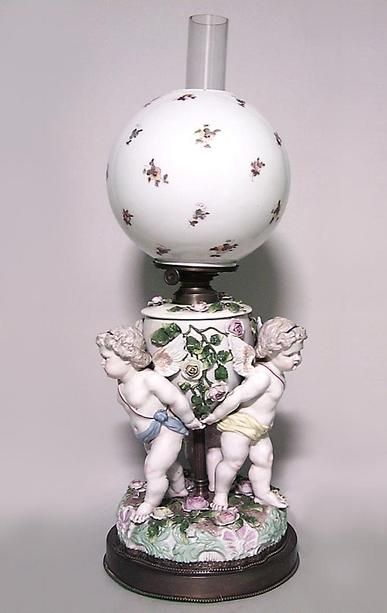French Victoiran Porcelain Oil Lamp With Triple Cupid Base And Decorated Globe With Chimney