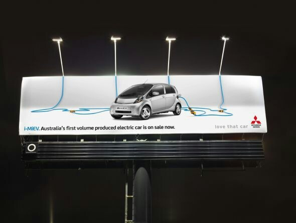 Electric Car Ad pulling energy from Billboard Lights
