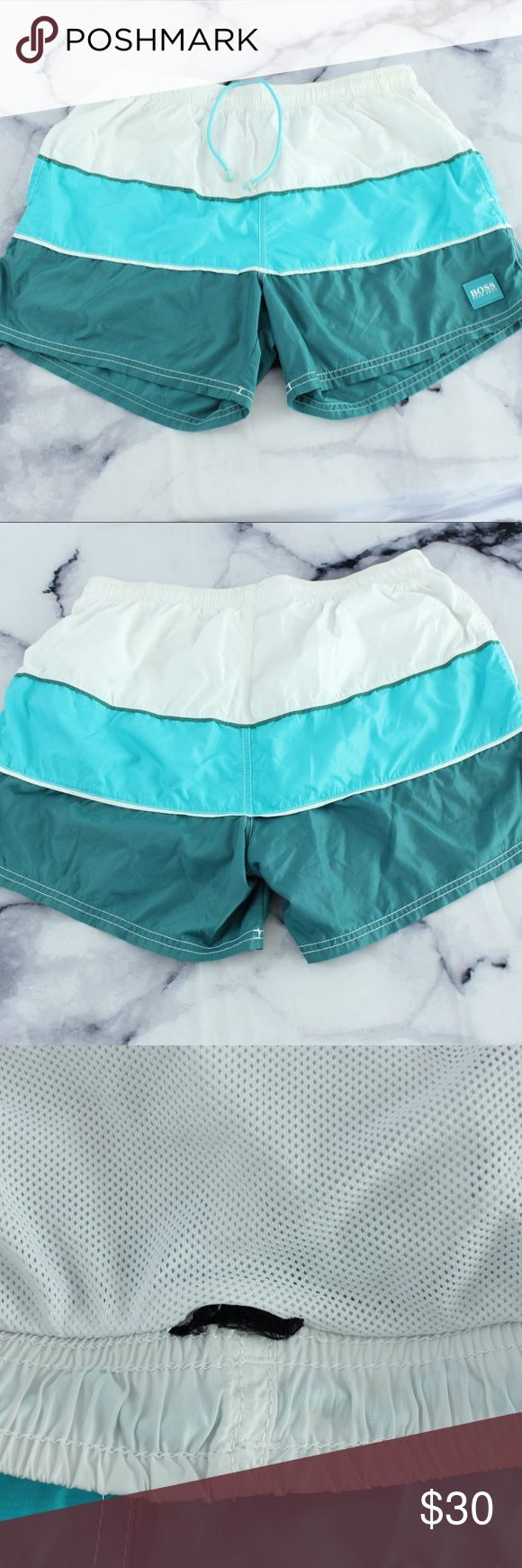 "Hugo Boss Teal Color Block Swim Trunks 32 Condition: USED Stretch: YES waist stretches slightly (approx 1.75"") Piling or Flaws: tags have been cut. Waist measures approx 32"" Feel free to make an offer or bundle what you like and ill send you an offer with a bangin' duscount!🖤 Hugo Boss Swim Swim Trunks"