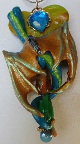 This unique one of a kind jewelry pendant was sculpted by hand in Premo polymer clay. This is a Love Dragon, the draconian embodiment of love. When worn close to your heart she takes your love and amp
