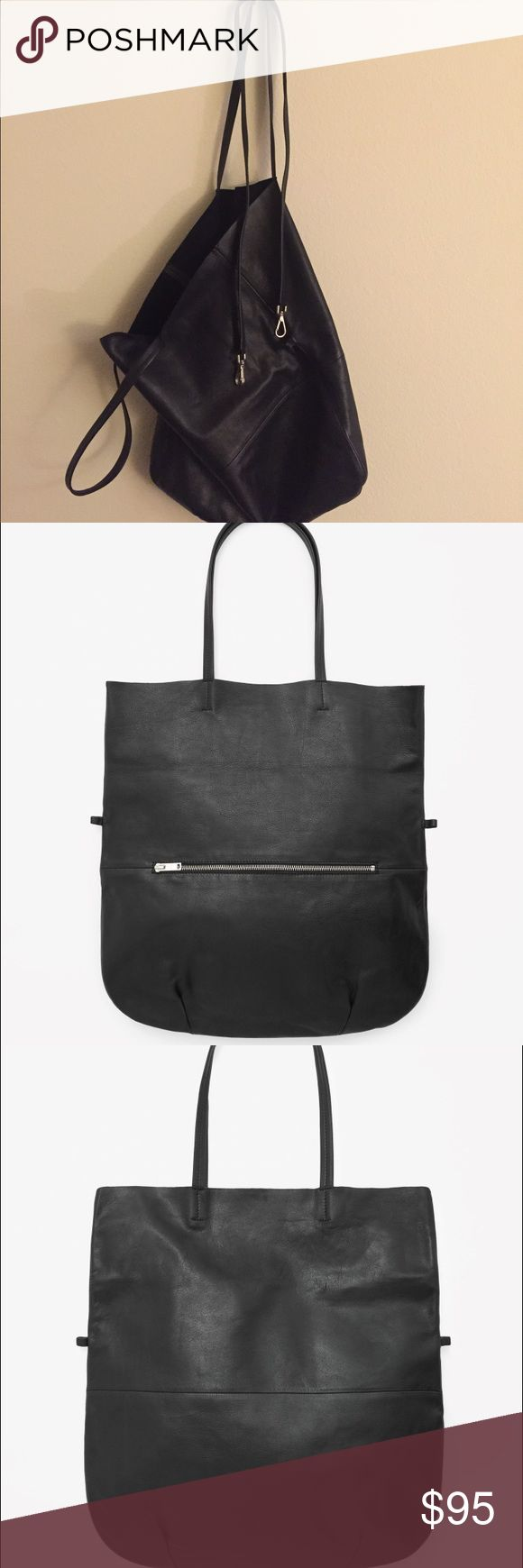 COS raw edge leather tote bag: Used once! This large leather shopper is made from soft, raw-cut leather with a single unlined compartment and smaller zip pocket on the front. A relaxed shape that folds over, it can be held by the handle or worn over the shoulder using the detachable leather strap. COS  Bags Totes