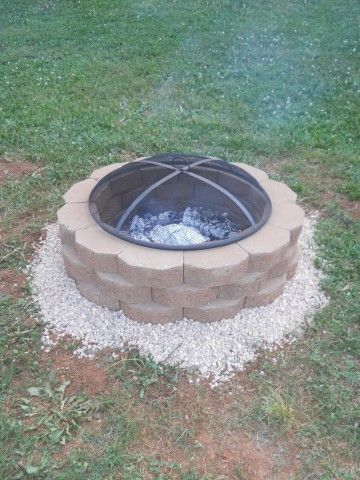 DIY firepit: 36 retaining wall stones from Lowes   1 bag of Sand  1 bag of Pea…