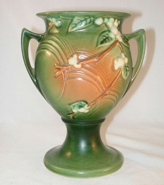 """Description: A most beautiful, very uncommon, and rare green colored art pottery vase by the Roseville Pottery Company. This a nice size (~8 3/8"""" tall) trophy shaped vase in the snowberry pattern. It"""