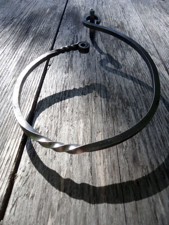Unique Forged Iron Towel Ring. Hangs off the wall to allow for efficient drying while still saving space.