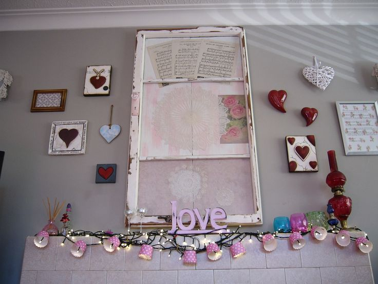 My Wall of Love & Hearts, all different styles surrounding an up-cycled window from our First Home. I Love Doillies and Vintage inspired Prints and Music Sheets, had to add the crystal knob  - its an open window from the past to the future.