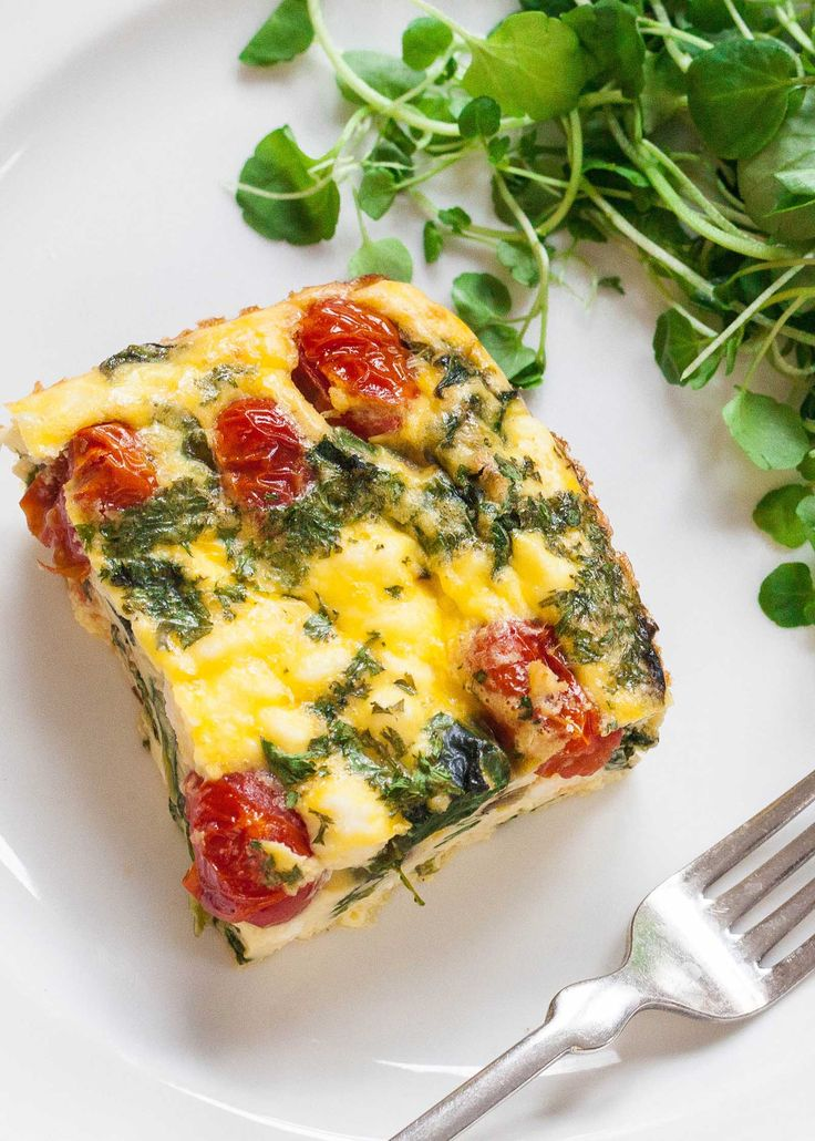 I love this frittata with spinach, tomatoes, and feta cheese! It's a perfect make-ahead breakfast. Bake all in one dish, then reheat squares during the week. (Gluten-free, Vegetarian)