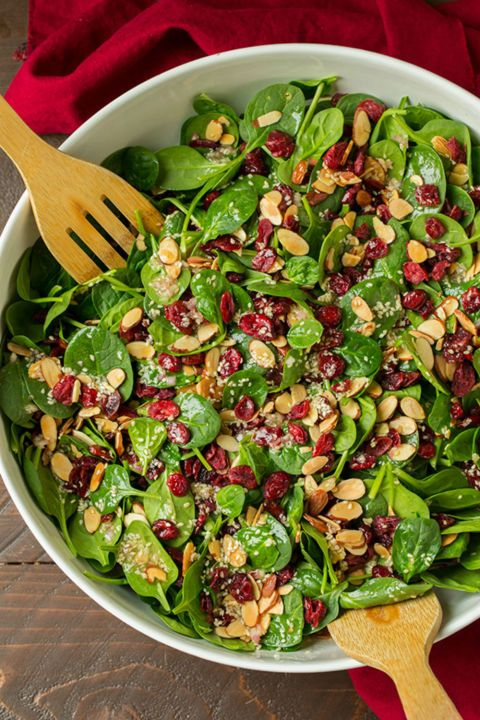 Cranberry Almond Spinach Salad: Full of tart cranberries, crisp spinach leaves and crunchy almonds this holiday dish beats any old traditional salad. Find more easy and delicious non-traditional and traditional Christmas dinner menu ideas and recipes including appetizers, entrees, desserts, drinks and main courses here.