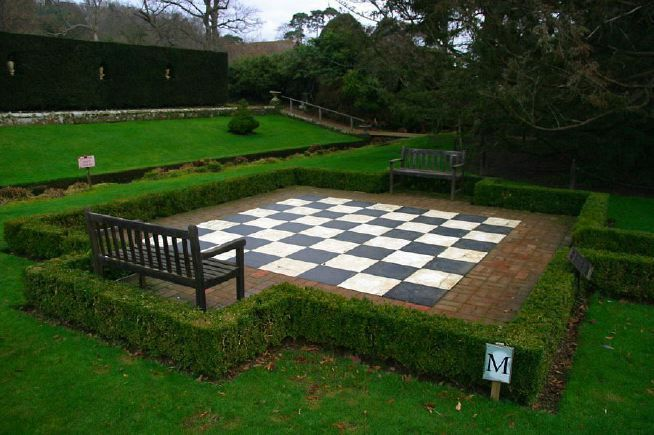 """This is a simple, formal garden with a big chess set,"""" says Halstead of the area just off the front porch. Description from pinterest.com. I searched for this on bing.com/images"""