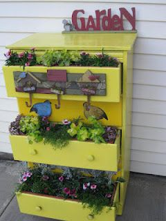 Kind of digging the re-use of this dresser as a stacked planter - now I know what to use for that weird part of the garden that needs vertical plantings....  Patti's Creations: Recycle, Reuse, Repurpose a Dresser as a Planter
