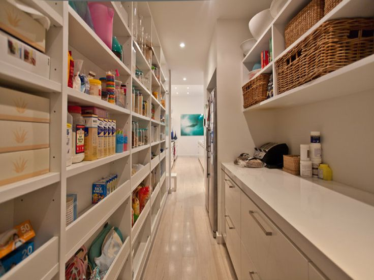 Great idea for a narrow pantry. there are narrow shelves on one side and a full counter with deep shelves on other