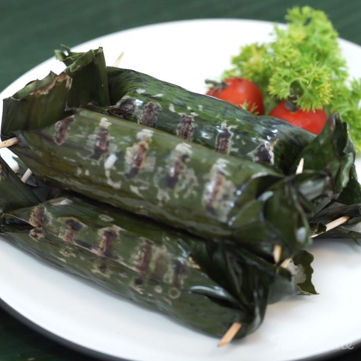 One of the popular snacks are always present at important events is usually made of glutinous rice filled with shredded or chopped chicken meat and wrapped in banana leaves. There are steamed lemper and some that burn it after steaming, the aroma and taste of burnt banana leaves make lemper's taste becomes more palatable.