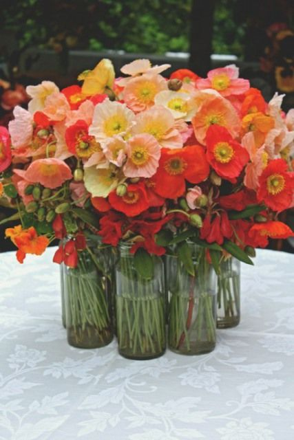 poppies orange reception wedding flowers, wedding decor, wedding flower centerpiece, wedding flower arrangement, add pic source on comment and we will update it. www.myfloweraffair.com can create this beautiful wedding flower look.