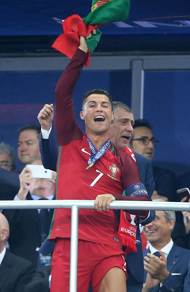 Ronaldo of Portugal celebrates the victory during the trophy ceremony following the UEFA Euro 2016 final match between Portugal and France at Stade de...