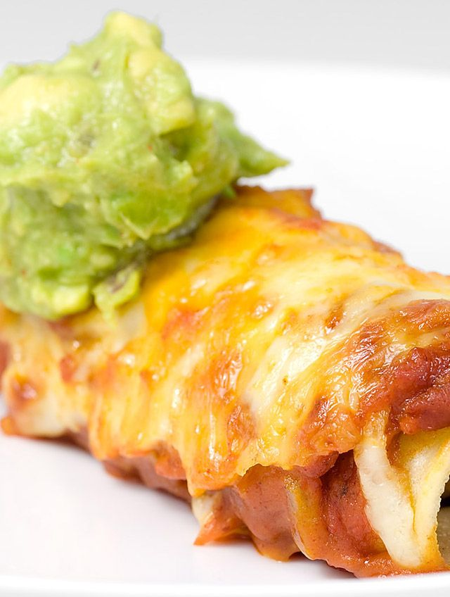 Pulled pork filled enchiladas topped with a homemade enchilada sauce and cheese and baked until bubbly.