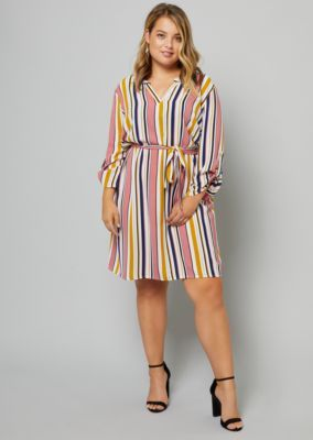 e9cc8909eebb0 This breezy shirt dress is made of a lightweight crepe fabric in a plus size.  Detailed with a notched stand collar