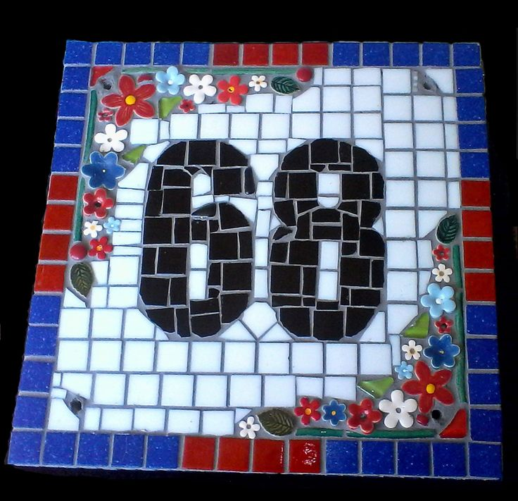 Very simple house number made from old swimming pool mosaic tiles, glass mosaic tiles and pottery flowers. Birthday present for a friend