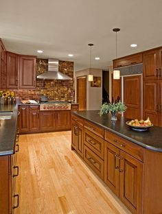 Low Voltage Decorative Pendant Lighting Is Featured Above The New Central Kitchen Island Light Red Oak Hardwood Flooring Contrasts Against Darker