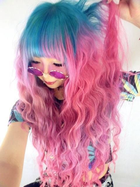 Curly pink and blue hair with bangs