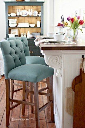 ikea billy bookcases serve as kitchen island embellished with fancy bar stools