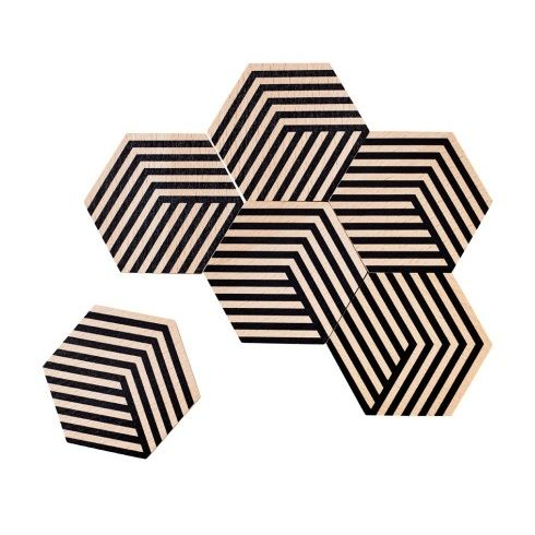 This set of six coasters can be artfully arranged to form a tiled trivet. The illusion of 3D through color and geometry allows for endless permutations, encouraging playful mosaic building on your table.