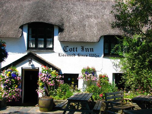Cott Inn, Dartington, south Devon.  Believed to be the oldest pub in England (there are several that make this claim) the Cott Inn has held a continuous licence since 1320. According to some sources, it's an excellent pub with quite good food.