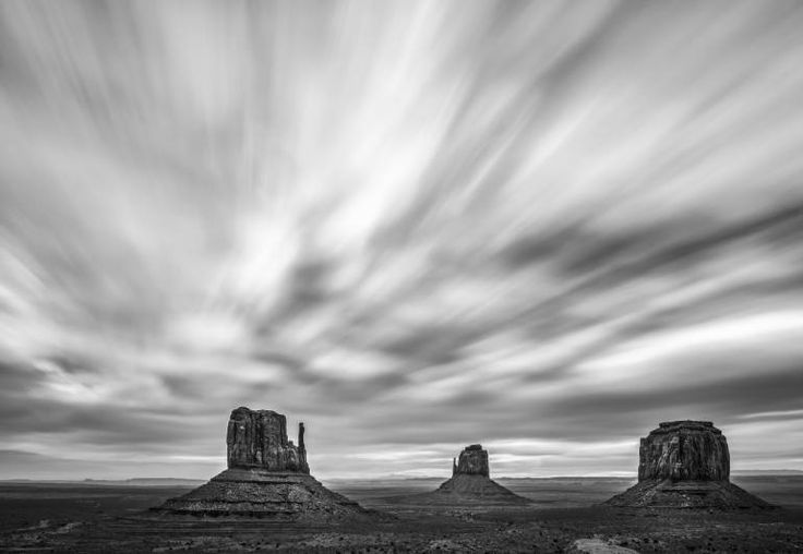"""Buy Monumental Clouds, a Digital on Paper by Jon Glaser from . It portrays: Landscape, relevant to: Arizona, INDIAN, clouds, monument valley, navajo, reservation, landscape, nature, outdoors Monument Valley (translated to """"valley of the rock"""") is part of the Colorado Plateau. It is  made up of a cluster of huge sandstone buttes, the largest scaling 1,000 ft above the floor of the valley. It is located near the Four Corners area part of the Arizona/Utah border. The valley is par..."""
