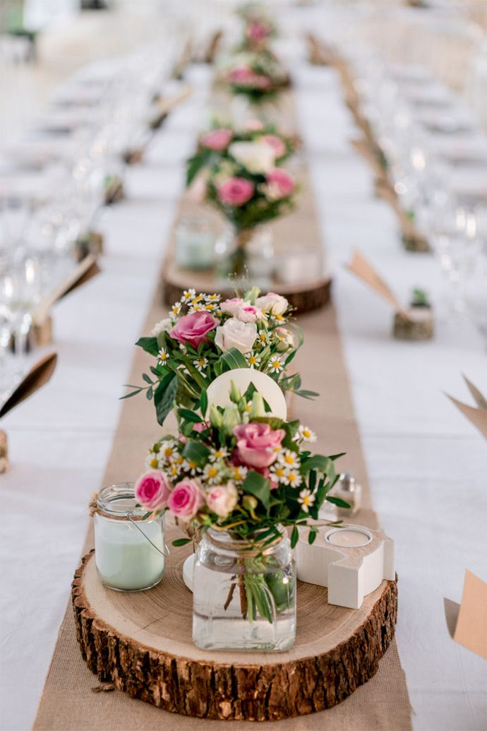 Beautiful Centerpieces in rose and white on wood discs.