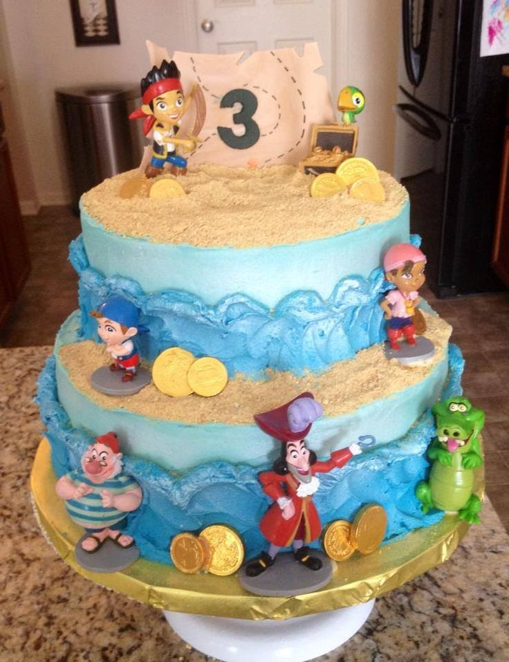 """Jake and the Neverland Pirates - all buttercream waves with graham cracker """"sand"""". The map was had cut from gumpaste!"""