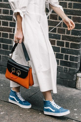Cool Casual Tom Boy Street Style Black And Orange Bag With Beige Long Midi Spring Dress And Bright Blue And White Old-Stlye High-Top Vans Sneakers