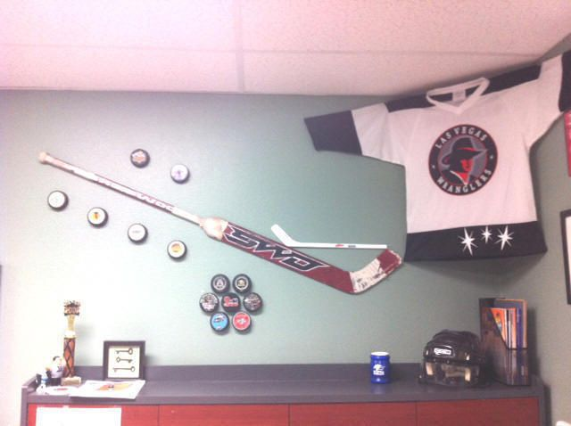 That's a mighty fine hockey jersey and puck/stick display!
