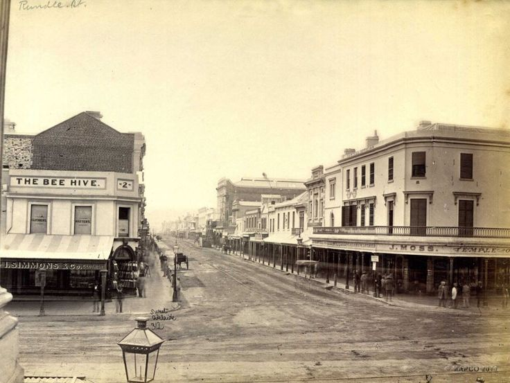 This is one of Bee Hive corner back also in 1880 where Rundle Mall would meet with King William Street today. No dome with a bee on it here. It's actually the name of a drapery shop. The current Beehive building would be built just five years later.