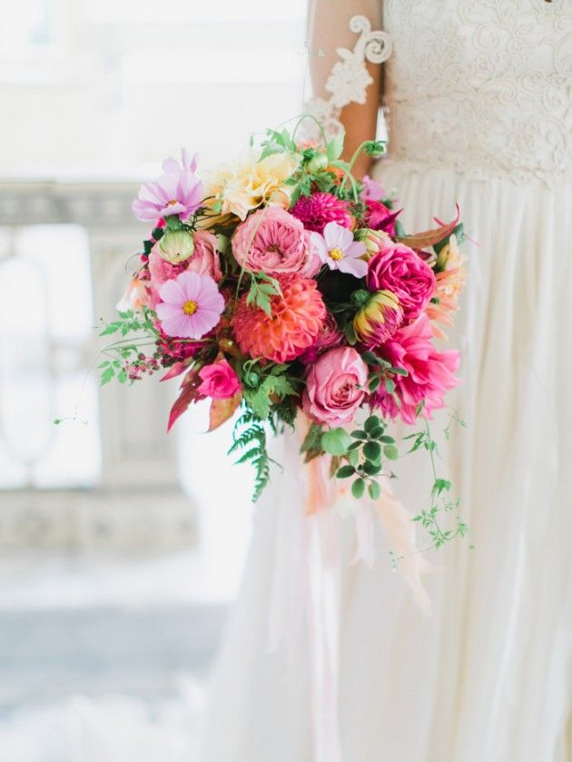Spring Wedding Bouquet of colorful dahlias, garden roses, cosmos, zinnia, and greens