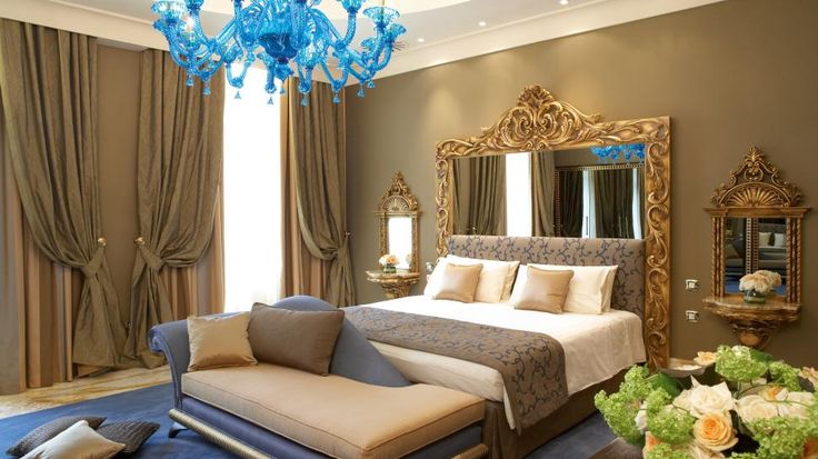 Best use of blue and tan in a bedroom, lots of draped curtains and over sized mirrors, great formal look but very cozy and romantic chic