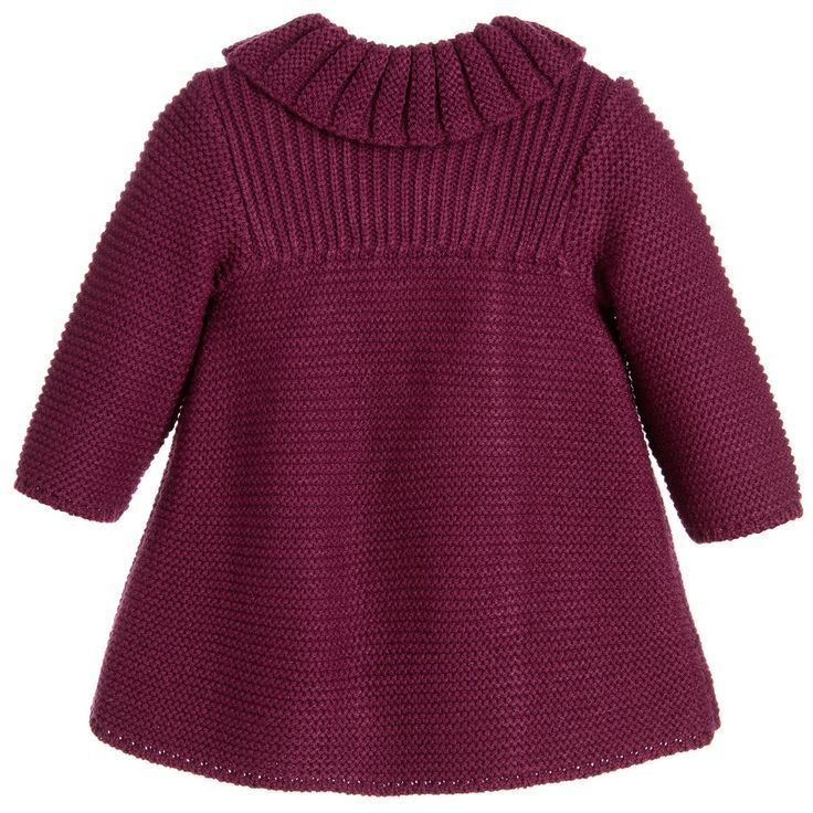 Baby girls burgundy red traditional heritage style knitted coat and bonnet set by Foque. This charming styled outfit is ideal to be worn as a pram coat on colder days. It has a soft feel and a ribbed collar and trim, with popper fastening and a rabbit fur pom-pom on the side. The matching bonnet has ribbon ties that secure in a bow under the chin – Baby World