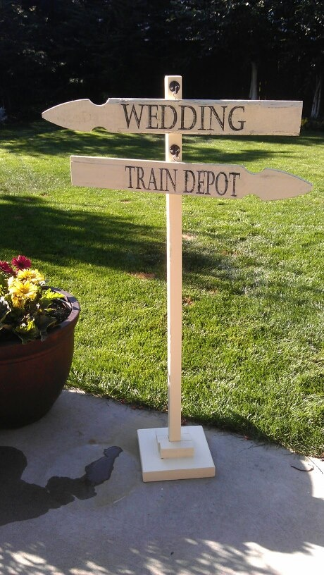 Wedding sign for vintage travel theme(train station).  picket fence for arrows, cup hooks on sign and vintage hooks for hangers