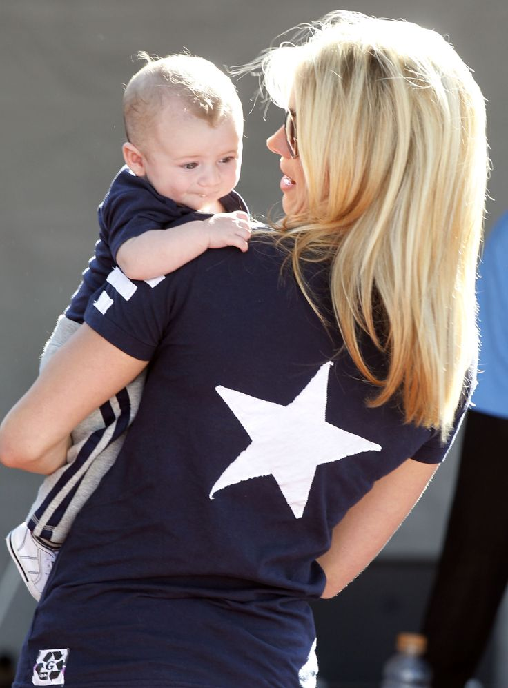 Future Cowboys QB? Hawkins Romo makes an appearance at training camp with his mom, Candice Crawford Romo.