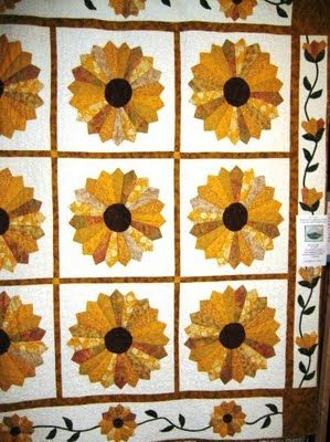 Google Image Result for http://4.bp.blogspot.com/_SnuySFTmjG4/SreFKW4tgoI/AAAAAAAAG-g/XkEn4kNPwhM/s400/sunflower%2Bquilt.JPG