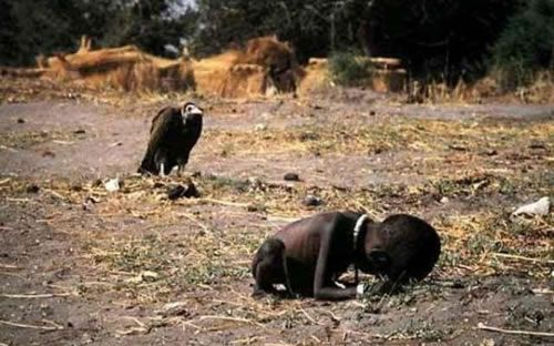 """Kevin Carter, the photographer behind this image, would later commit suicide. His note reads: """"I am haunted by the vivid memories of killings and corpses and anger and pain ... of starving or wounded children, of trigger-happy madmen, often police, of killer executioners..."""""""
