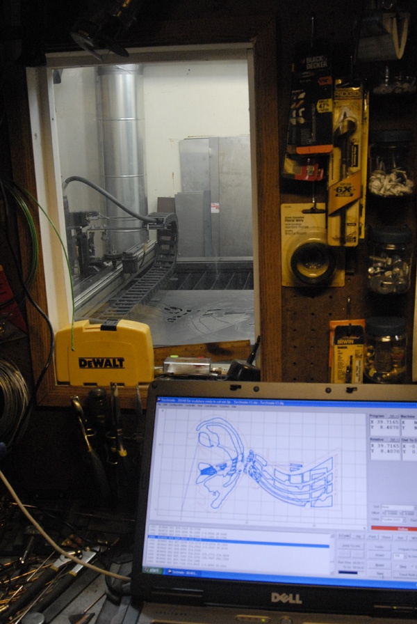 View from air-conditioned shop, looking into CNC cutting room.