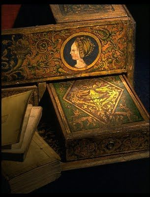 Detail of Henry VIII's writing box c. 1525. This impressive writing box was almost certainly created in the court workshops of Henry VIII (reign: 1509 to 1547). Lined with leather it is painted with the heraldic badges of Henry VIII and his first queen, Katherine of Aragon (1485-1536), as well as the royal coat of arms.