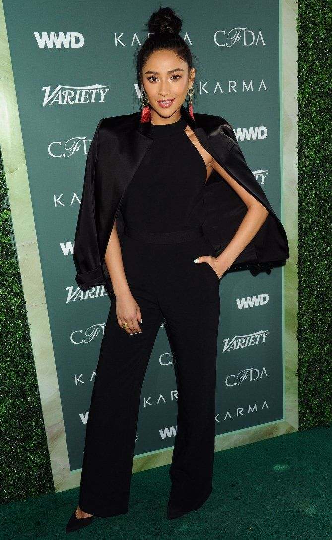 Shay Mitchell in a black cape and jumpsuit