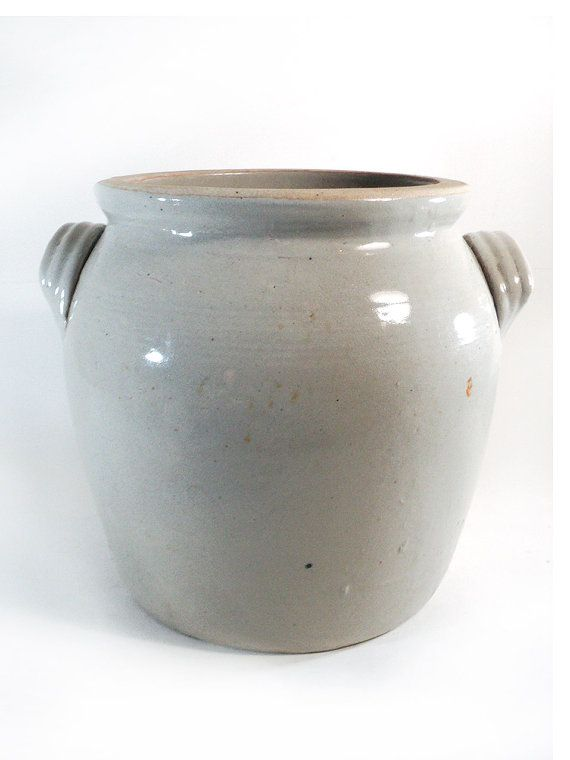Big French light beige glazed earthenware confit pot with ears. This French beige-gray earthenware confit pot would give a rustic or minimalist style to your home.  Can be used both in the kitchen to stock your utensils and as a flowerpot.   Good vintage condition, a crack near one ear, some normal color variation (see photos).  Height: 27 cm // 10.6in Diameter (top): 23 cm // 9.06in Weight: +5 kg // 11lb   Check out our other glazed pottery jars: www.etsy.me&#x2...