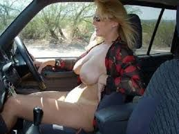 milf driving car topless with caption
