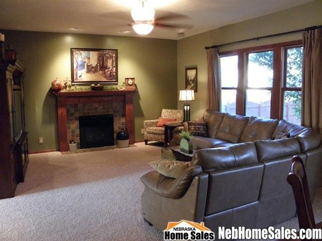 Earth tone colors ancient wall in living room green