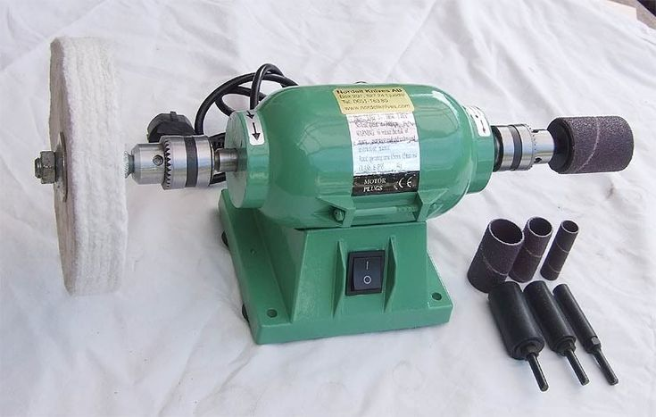 Bench grinder with drill chucks