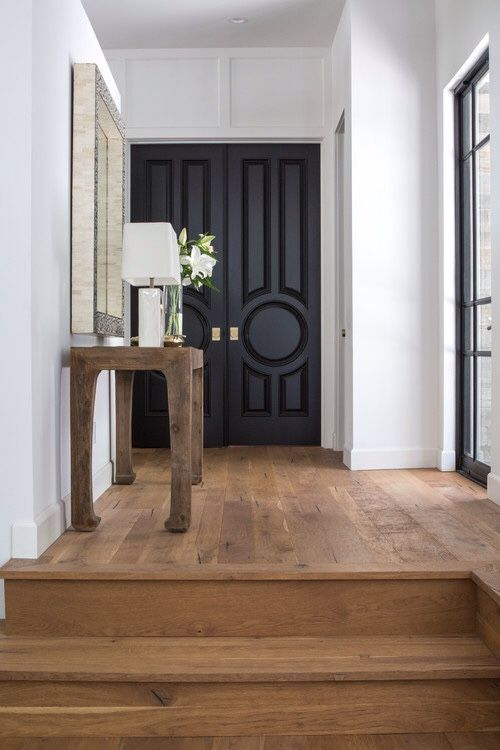 The Neutral Colors Of This Entryway Are Gorgeous. Itu0027s So Simple Yet  Welcoming; The Black Doors Contrast Amazingly W/ The White Walls U0026 Wood  Floors!