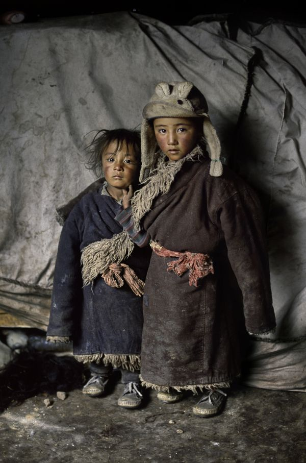 Nothing is surplus among the nomadic tribes that traverse the high plains of Tibet. This portrait of two nomad children reveals how the yaks that supply a tribe's meat and milk, also supply its clothing. From the food in their stomachs to the clothes on their backs, this is a way of life in which everything serves a purpose..... This was photographed in Amdo, Tibet by Stephen McCurry