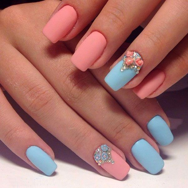 Two-colors nail art: blue and pink nails with rhinestone