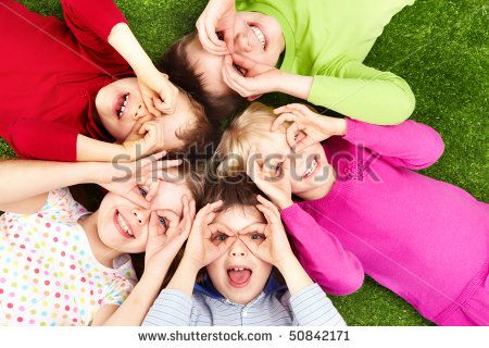 Image of funny kids playing on the grass - stock photo